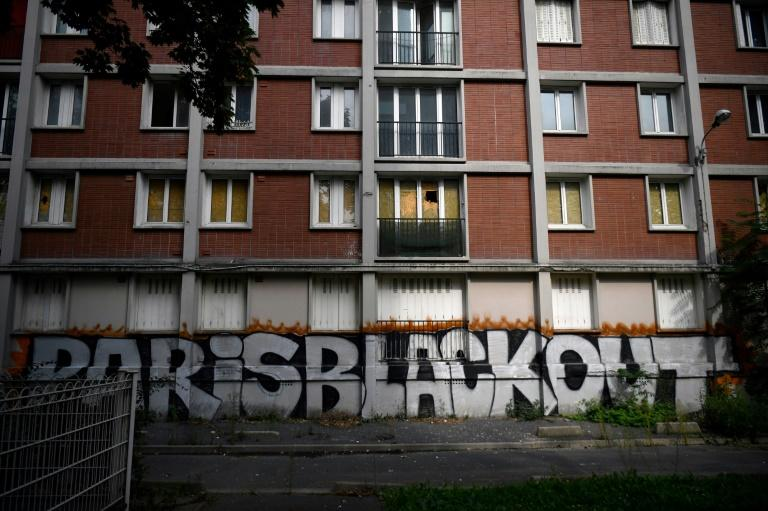 Graffiti and boarded-up windows now dot the Cite Gagarine in Ivry-sur-Seine