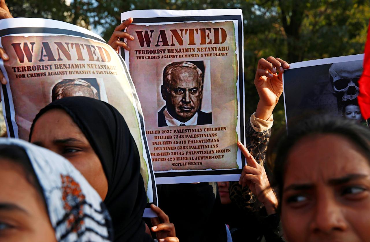 Women hold placards during a protest against the visit of Israeli Prime Minister Benjamin Netanyahu, in Mumbai, India, January 18, 2018. REUTERS/Shailesh Andrade   NO RESALES. NO ARCHIVES