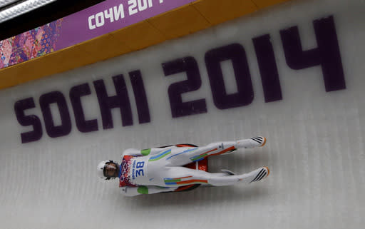 Shiva Keshavan, who if from India but is competing under the Olympics flag, takes turn five in the third run during the men's singles luge final at the 2014 Winter Olympics, Sunday, Feb. 9, 2014, in Krasnaya Polyana, Russia. (AP Photo/Dita Alangkara)