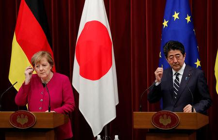 German Chancellor Angela Merkel (L) and Japan's Prime Minister Shinzo Abe attend a joint news conference in Tokyo, Japan, February 4, 2019. REUTERS/Kim Kyung-hoon
