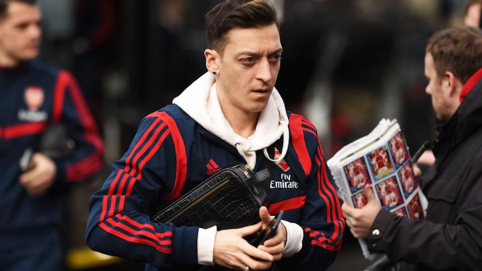 Arsenal midfielder Mesut Ozil has been axed by the Premier League club, but will continue to earn his record salary. (Photo by OLI SCARFF/AFP via Getty Images)