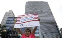 A young girl holds a placard protesting against U.S. President Donald Trump's immigration policies in New York City, U.S., June 26, 2018. REUTERS/Brendan Mcdermid