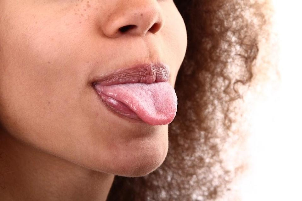 """Before you hit the hay for the night, take a minute to scrape or brush your tongue after cleaning your teeth. A 2013 study published in the <em>International Journal of Clinical Pediatric Dentistry</em> revealed that brushing and scraping your tongue are both effective means of <a href=""""https://www.ncbi.nlm.nih.gov/pmc/articles/PMC4086606/"""" rel=""""nofollow noopener"""" target=""""_blank"""" data-ylk=""""slk:reducing overall oral plaque and bacteria"""" class=""""link rapid-noclick-resp"""">reducing overall oral plaque and bacteria</a>, both of which have been linked to increased cardiovascular disease risk."""