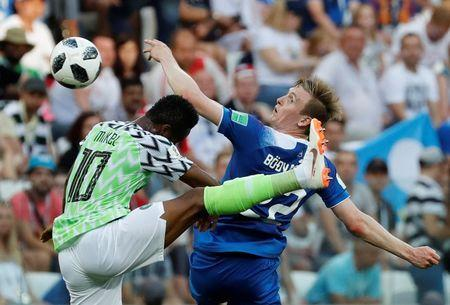 Soccer Football - World Cup - Group D - Nigeria vs Iceland - Volgograd Arena, Volgograd, Russia - June 22, 2018 Nigeria's John Obi Mikel in action with Iceland's Jon Dadi Bodvarsson REUTERS/Toru Hanai