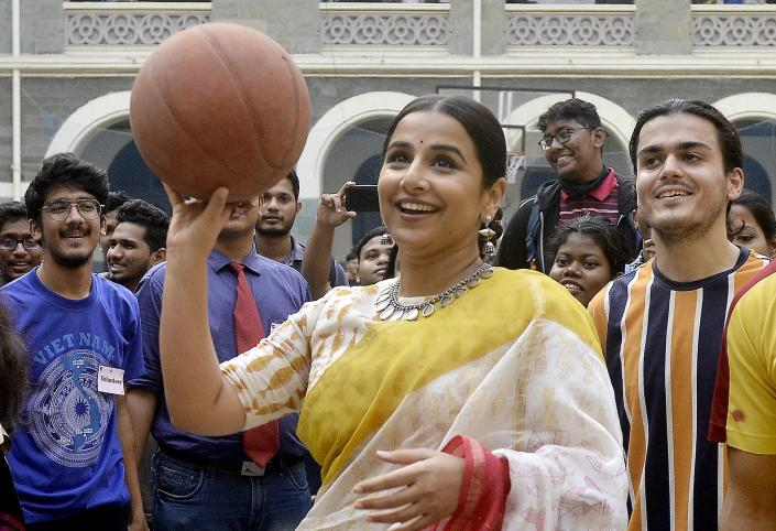 Vidya Balan plays basketball with students of St. Xaviers College in Mumbai. (Photo by Milind Shelte/India Today Group/Getty Images)