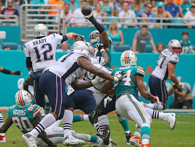 <p>Miami Dolphins defensive tackle Ziggy Hood blocks a pass by New England Patriots quarterback Tom Brady (12) during the second quarter on Sunday, Dec. 9, 2018 at Hard Rock Stadium in Miami Gardens, Fla. (David Santiago/Miami Herald/TNS) </p>