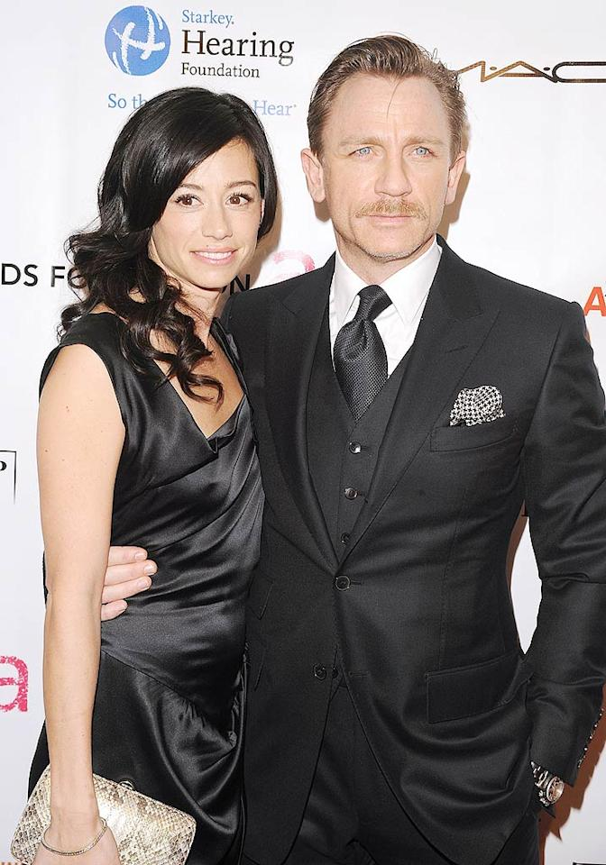 """Is Daniel Craig secretly bond-ed by marriage? The 007 star has recently been sporting a band on his ring finger, prompting the tabs to report that he quietly wed his longtime girlfriend. See what <a href=""""http://www.gossipcop.com/daniel-craig-not-bonded-by-secret-marriage/"""" target=""""new"""">Gossip Cop</a> has uncovered about his """"Goldfinger."""" Andrew H. Walker/<a href=""""http://www.wireimage.com"""" target=""""new"""">WireImage.com</a> - November 16, 2009"""