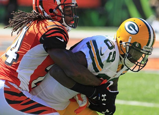 Green Bay Packers wide receiver James Jones (89) is tackled by Cincinnati Bengals cornerback Adam Jones in the second half of an NFL football game, Sunday, Sept. 22, 2013, in Cincinnati. (AP Photo/Tom Uhlman)