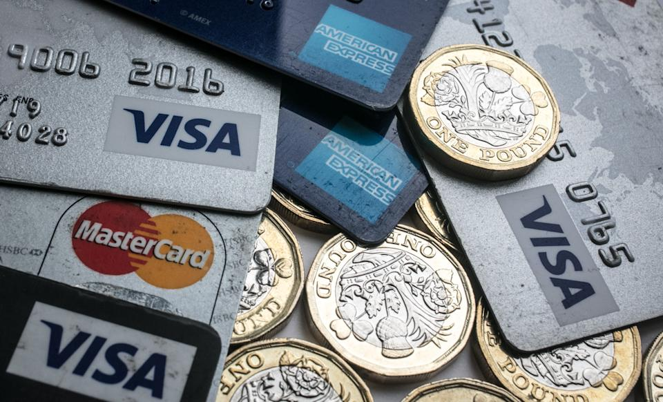 BRISTOL, ENGLAND - NOVEMBER 03:  In this photo illustration credit and debit cards are seen alongside pound coins on November 3, 2017 in Bristol, England. The Bank of England raised interest rates from a historic low for the first time in ten years this week raising costs of lending and concerns for householder debt.  (Photo by Matt Cardy/Getty Images)