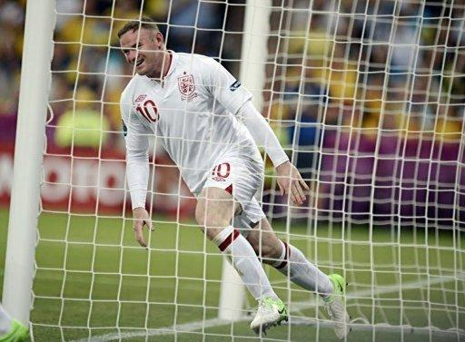 English forward Wayne Rooney celebrates after scoring during the Euro 2012 football championships match England vs Ukraine at the Donbass Arena in Donetsk. Rooney lifted England into the quarter-finals of Euro 2012 on Tuesday with a 1-0 win over co-hosts Ukraine