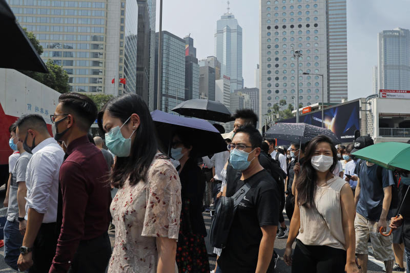 Protesters march with face mask during a flash mob protest in Hong Kong, on Friday, Oct. 11, 2019. Hundreds of masked protesters gathered at Chater Garden in central Hong Kong on Friday to rally against police brutality and show their support for students who have been arrested during the ongoing anti-government demonstrations. (AP Photo/Kin Cheung)