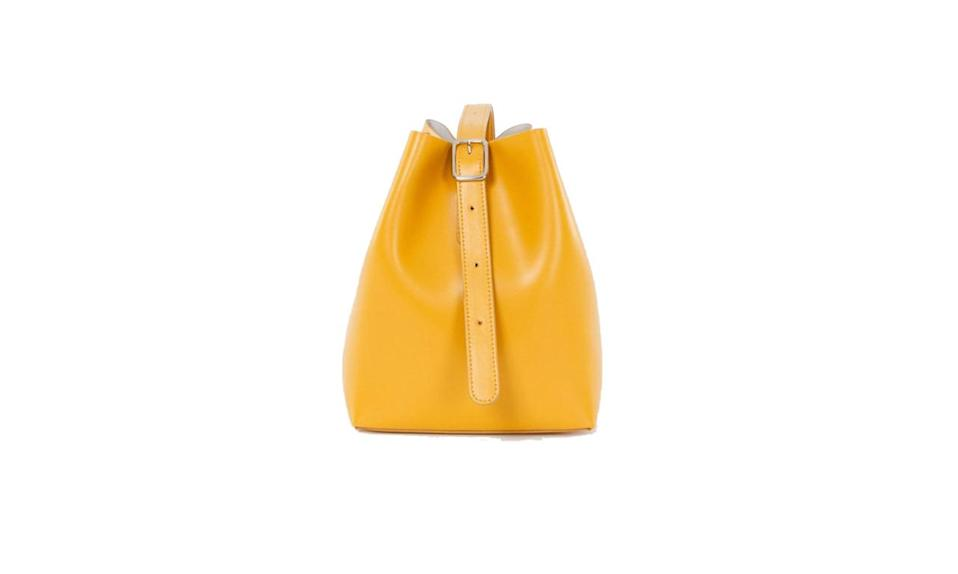 "<p>A splash of color from downtown NYC's favorite label, Creatures of Comfort. </p><p>Creatures of Comfort Bucket bag Small Calf Leather, $495, <a href=""https://creaturesofcomfort.us/collections/bags/products/bucket-bag-small-calf-leather-3"" rel=""nofollow noopener"" target=""_blank"" data-ylk=""slk:creaturesofcomfort.com"" class=""link rapid-noclick-resp"">creaturesofcomfort.com</a></p>"