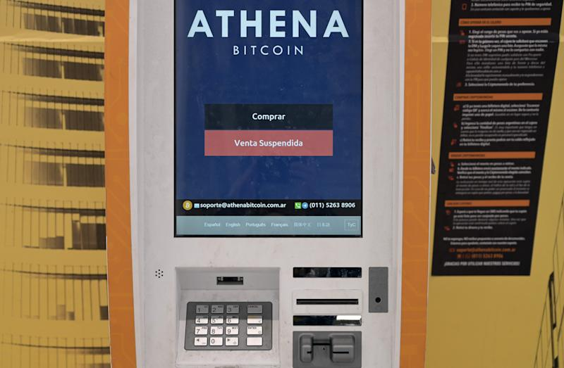 View of an ATM machine for digital currency Bitcoin with it sales suspended at a supermarket in Buenos Aires on August 15, 2019. - Argentine President Mauricio Macri on Thursday reinforced his battery of relief measures in order to face an expected rise of inflation, by eliminating the sales tax on some food products until the end of year, following a crushing defeat in party primaries over the weekend. (Photo by JUAN MABROMATA / AFP) (Photo credit should read JUAN MABROMATA/AFP via Getty Images)
