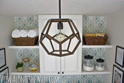 """<div class=""""caption-credit""""> Photo by: View Along the Way</div><b>Dodecahedron Pendant Light Fixture</b> <br> While the dodecahedron (12 pentagonal faces, 3 meeting at each vertex) model might have been suggested as the global geometry of the universe, all we see is a magnificent masterpiece of lighting design. Made from 30 pieces of wood, this pendant light fixture is a DIYer's dream! <br> <i>Get the full tutorial at <a href=""""http://www.viewalongtheway.com/2013/01/diy-dodecahedron-pendant-light-and-an-announcement/"""" rel=""""nofollow noopener"""" target=""""_blank"""" data-ylk=""""slk:View Along the Way"""" class=""""link rapid-noclick-resp"""">View Along the Way</a> <br></i> <br> <b><i><a href=""""http://www.babble.com/home/20-diy-headboard-ideas-to-make/?cmp=ELP