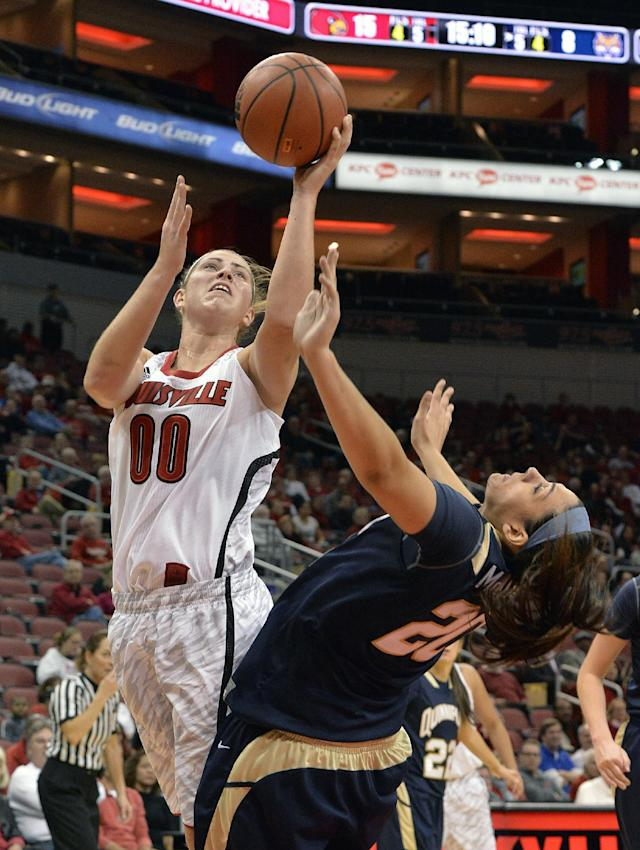 Louisville's Sara Hammond, left, gets a shot off over the defense of Quinnipiac's Brittany McQuain during the first half of an NCAA college basketball game, Monday, Nov. 11, 2013, in Louisville, Ky. (AP Photo/Timothy D. Easley)