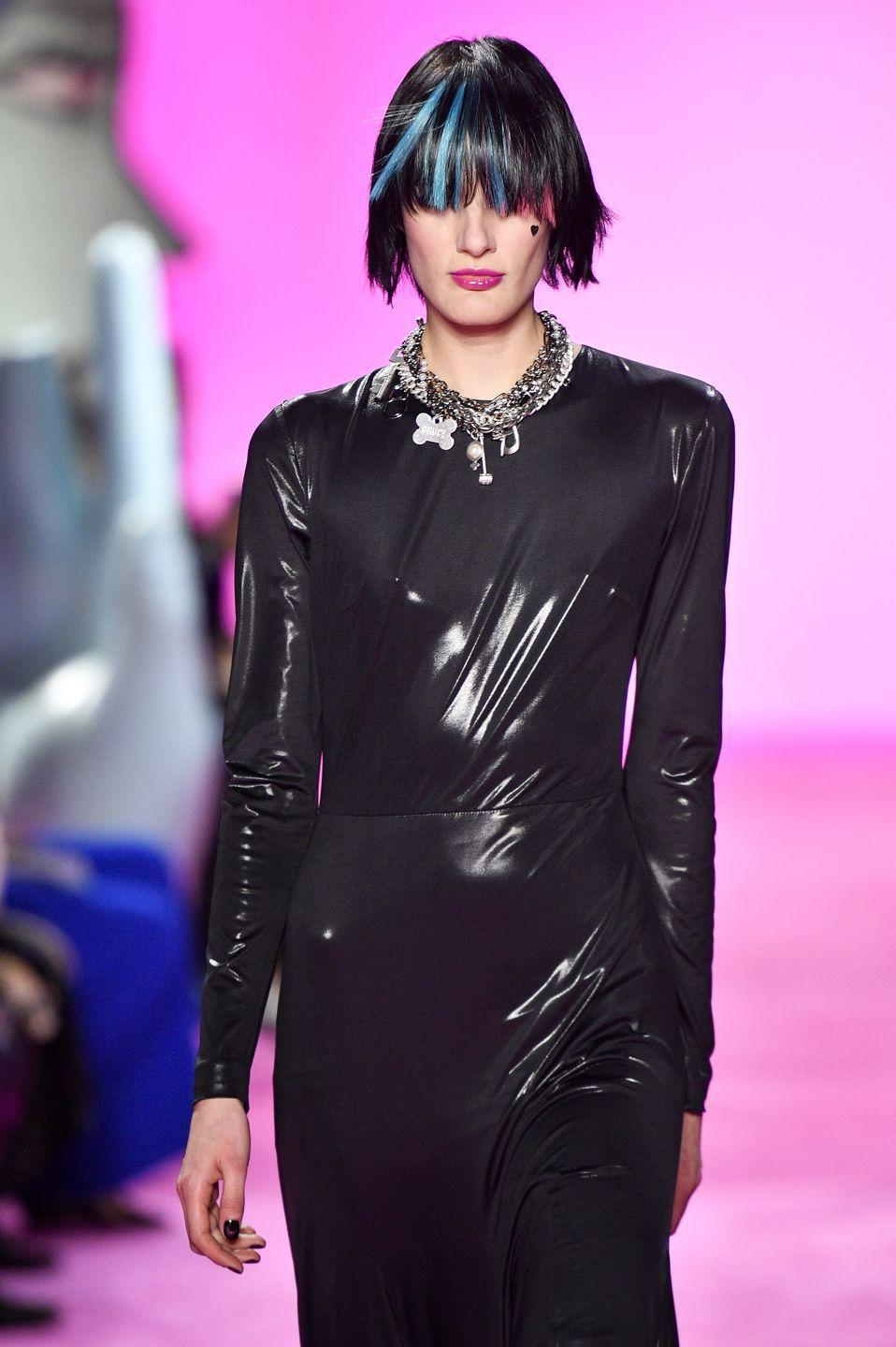 <p>Models at Christian Siriano also hit the runway with bright-colored streaks, tucked into either blunt bangs or long ponytails.</p>