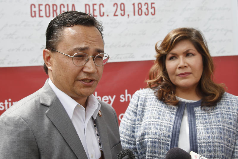 Cherokee Nation Principal Chief Chuck Hoskin Jr., left, answers a question for the media following his announcement that he is nominating Kimberly Teehee, right, as a Cherokee Nation delegate to the U.S. House, in Tahlequah, Okla., Thursday, Aug. 22, 2019. Hoskin Jr. acknowledged the first such attempt by a tribal nation will take time as well as cooperation from Congress. (AP Photo/Sue Ogrocki)