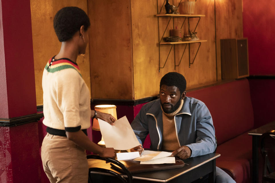 """This image released by Amazon Prime Video shows Letitia Wright as Altheia Jones-LeCointe, left, and Malachi Kirby as Darcus Howe in a scene from """"Mangrove."""" (Des Willie/Amazon Prime Video via AP)"""
