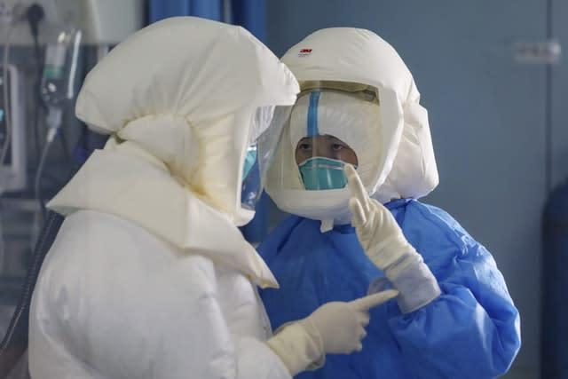 Medical staff work in the negative-pressure isolation ward in Jinyintan Hospital, designated for critical Covid-19 patients, in Wuhan, China