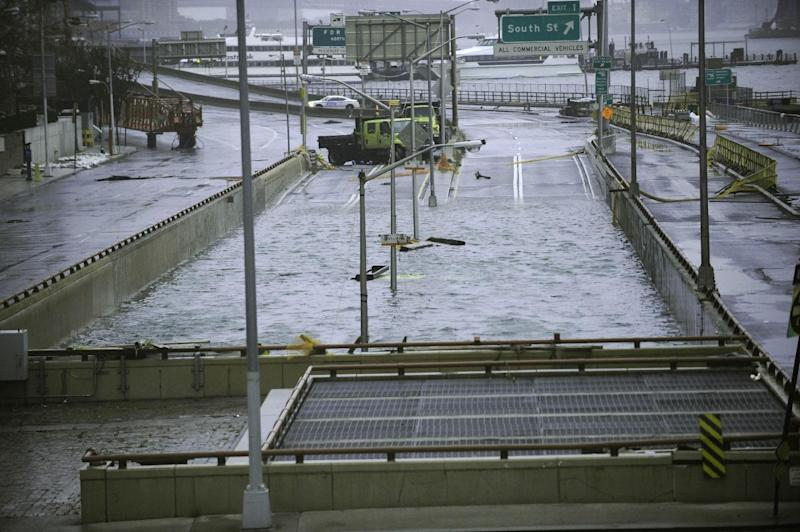 FILE - This Oct. 30, 2012 file photo shows water reaching the street level of the flooded Battery Park Underpass, Tuesday in New York, remnants from Superstorm Sandy. Extreme weather is a growing threat to the nation's lifelines _ its roads, bridges, railways, airports and transit systems _ leaving states and cities trying to come to terms with a new normal.  (AP Photo/ Louis Lanzano, File)