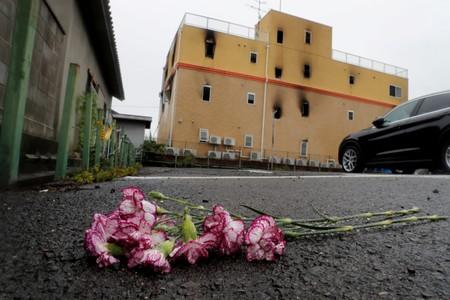 Flowers are placed in front of the torched Kyoto Animation building to mourn the victims of the arson attack in Kyoto