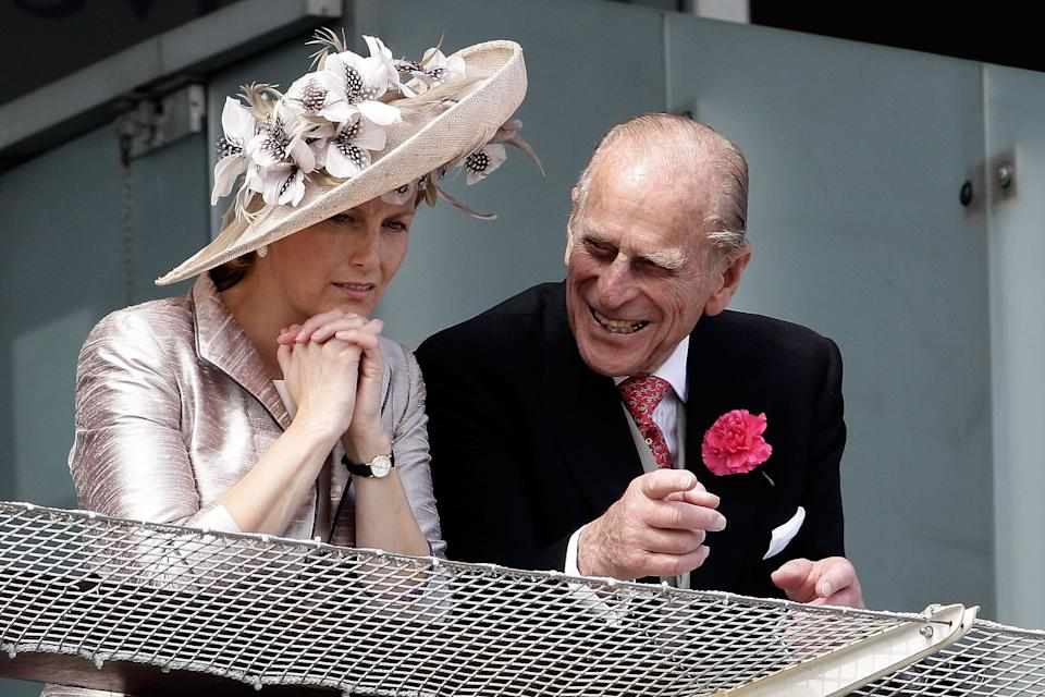 The Duke of Edinburgh (right) and Countess of Wessex wait for the start of the Epsom Derby on June 4, 2011, in Epsom, England. (Photo: Matthew Lloyd via Getty Images)
