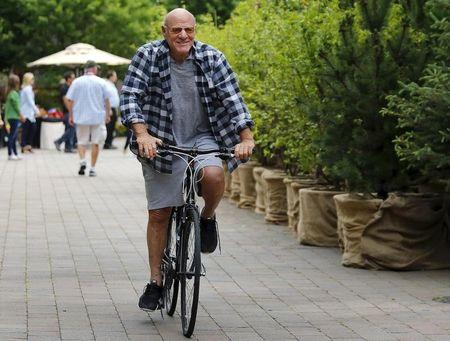 Diller rides a bike during the first day of the annual Allen and Co. media conference in Sun Valley