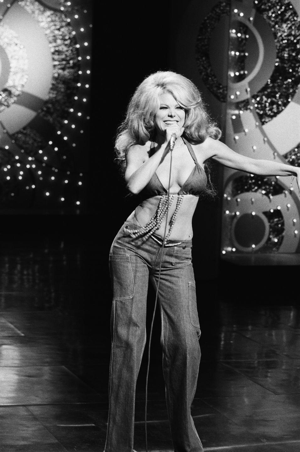 <p>Charo, on <em>The Tonight Show Starring Johnny Carson</em>, sports a low-rise pair that hits <em>several</em>inches below her belly button.</p>