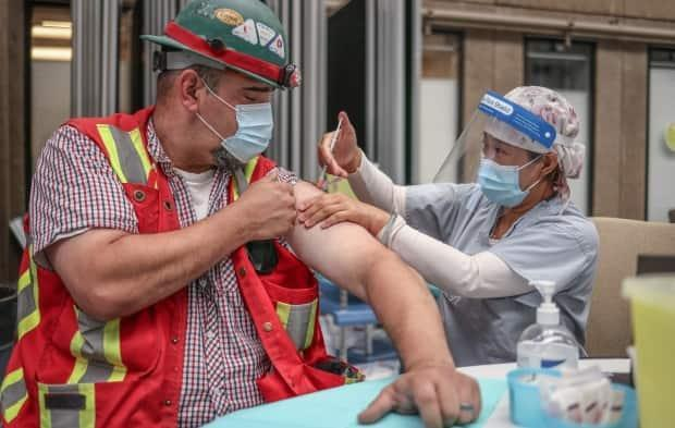Alberta Health reports that as of end of day Wednesday, 57.1 per cent of eligible Albertans were fully vaccinated. (AHS - image credit)