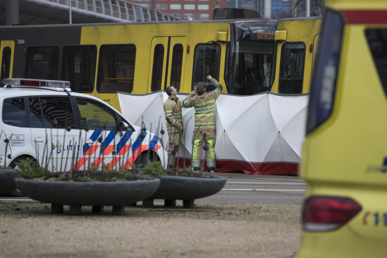 Rescue workers install a screen on the spot where a human shape was seen under a white blanket following a shooting in Utrecht, Netherlands, Monday, March 18, 2019. (Photo: Peter Dejong/AP)