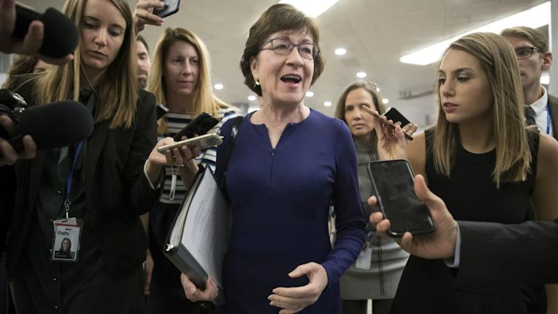 Sen. Susan Collins, R-Maine, is questioned by reporters as lawmakers arrive for a vote, at the Capitol in Washington, Tuesday, Oct. 17, 2017.