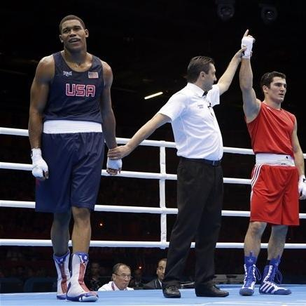 Russia's Artur Beterbiev is declared the winner over the United States' Michael Hunter II during a heavyweight 91-kg preliminary boxing match at the 2012 Summer Olympics, Wednesday, Aug. 1, 2012, in London. (AP Photo/Patrick Semansky)