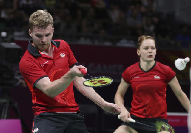 England's Marcus Ellis, left, and Lauren Smith play against their compatriots Gabrielle Adcock and Chris Adcock during their mixed doubles badminton final at Carrara Sports Hall during the Commonwealth Games on the Gold Coast, Australia, Sunday, April 15, 2018. (AP Photo/Dita Alangkara)