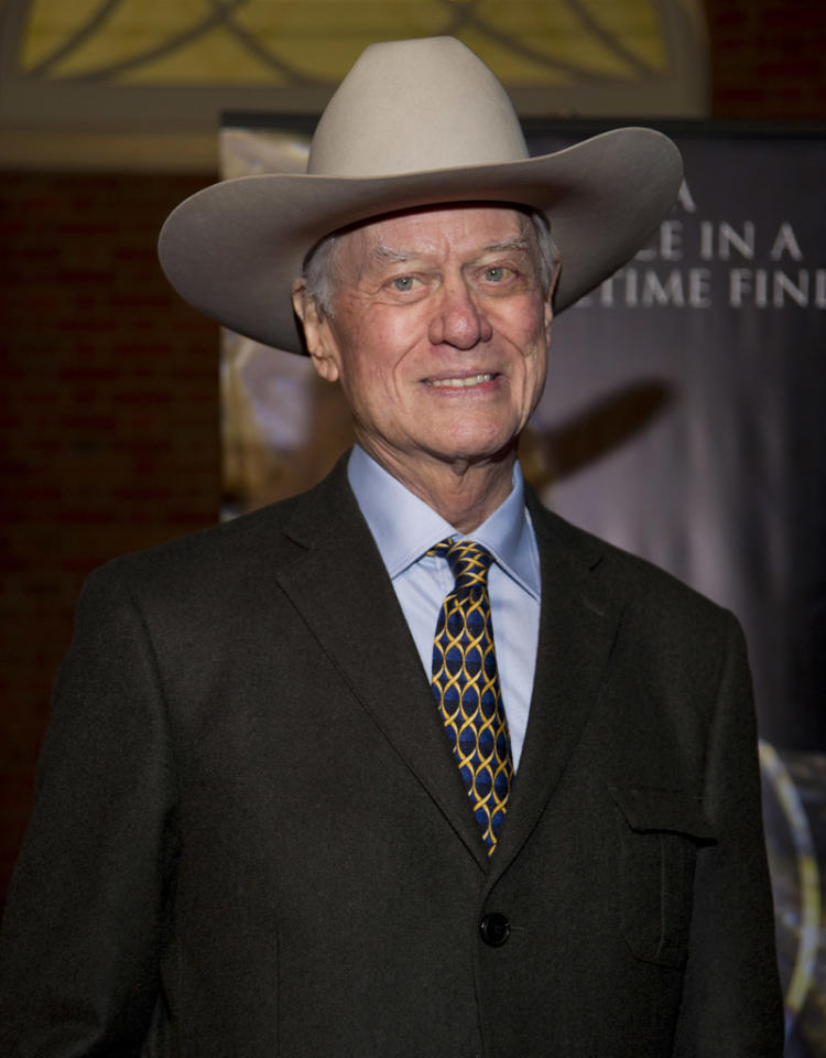 """DALLAS, TX - NOVEMBER 15:  Larry Hagman arrives for the White Bridle Society's """"Da Vinci, Wine and Roses"""" benefit at Lisa Blue Baron Mansion on November 15, 2012 in Dallas, Texas.  (Photo by Cooper Neill/WireImage)"""