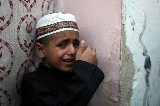 Palestinian Ahmed cries over the death of his father, Salafist leader Hisham al-Saedini during his funeral procession at Al-Bureij refugee camp in the central Gaza Strip