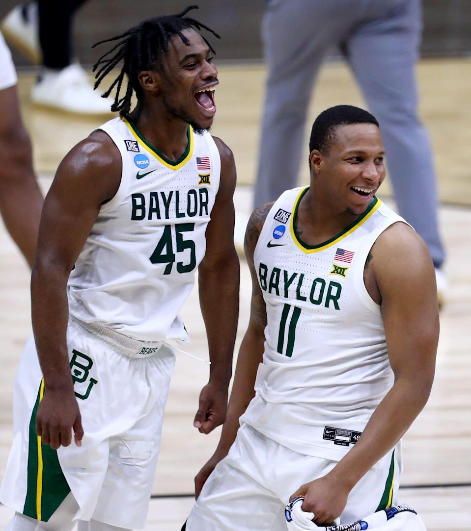 Davion Mitchell (45) and Mark Vital celebrate during Baylor's Elite Eight win over Arkansas.