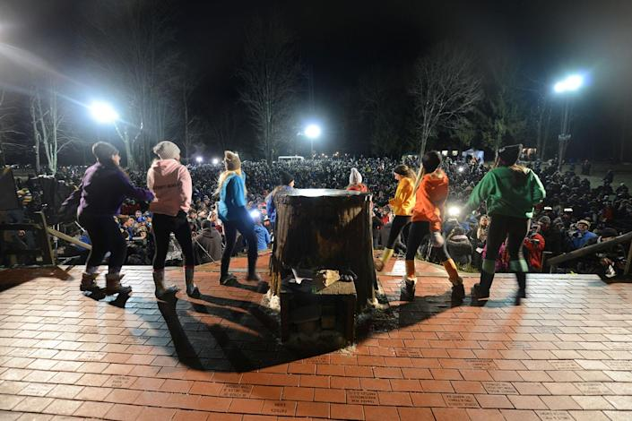 <p>Dancers entertain a crowd estimated at about 15,000 at Gobbler's Knob on the 131st Groundhog Day in Punxsutawney, Pa., Feb. 2, 2017. (REUTERS/Alan Freed) </p>