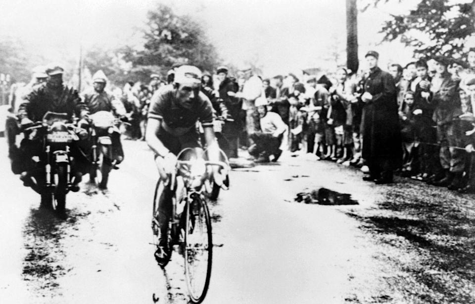 """<p>No fewer than eight riders wore yellow in this epic race, and the jersey changed hands 10 times. The race was animated by the greats of cycling's so-called golden age, like sprinter Andre Darrigade, who won five stages (and 22 total in his career); the Spaniard Federico Bahamontes, one of the best climbers—and worst descenders—the sport has ever seen; Raphael Geminiani, the Italian answer to Raymond """"Mr. Second Place"""" Poulidor and the inspiration for the <a href=""""https://www.rapha.cc/us/en_US"""" rel=""""nofollow noopener"""" target=""""_blank"""" data-ylk=""""slk:Rapha brand name"""" class=""""link rapid-noclick-resp"""">Rapha brand name</a>; and the enigmatic Charly Gaul, a fantastically gifted time trial rider and climber who had almost won the Giro d'Italia that year.</p><p>Despite his ferocious talent, Gaul didn't even crack the top 10 overall until Stage 14. After 17 stages (that year's Tour had 24 total) he was still almost 11 minutes down to leader Vito Favero. A convincing time trial win on Mont Ventoux began to cut into the margin, but he lost time again on Stage 20 and was just sixth overall, 16:03 down to Geminiani, and with major talents like Jacques Anquetil between him and the lead.</p><p>Then, on Stage 21, the last day in the Alps, racers awoke to a cold rain—a gift for Gaul, who delighted in bad weather. The stage was punishing: 219 kilometers with five major climbs. Gaul attacked out of the main group on the descent off the first climb, the Col du Lauteret, and rode through the remnants of the early break. On the second climb, Gaul dropped Bahamontes in a driving rain and forged on alone. At the finish, he was almost eight minutes ahead of the next rider; Gaul was now third, just 1:07 behind Favero. </p><p>Stage 23 was perfect for Gaul: an arduous 73-kilometer time trial, and he left little to suspense, winning his fourth stage and putting three minutes into Favero and Geminiani, a margin he easily held to the finish the next day in Paris.</p>"""
