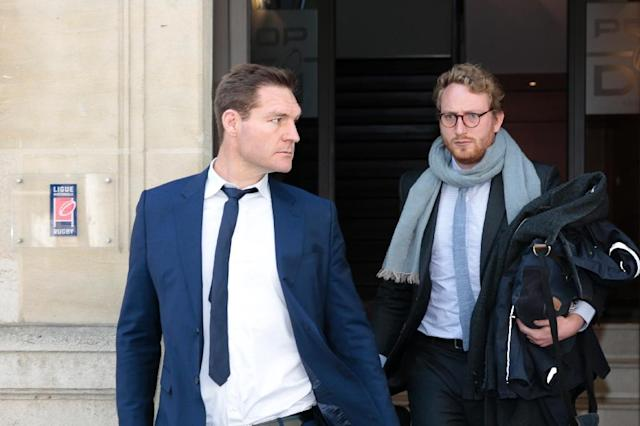 Former lock Ali Williams of New Zealand (L) leaves after appearing before the French National Rugby League disciplinary commission in Paris on April 12, 2017, after being fined by a French court for buying cocaine outside a Paris nightclub (AFP Photo/GEOFFROY VAN DER HASSELT)