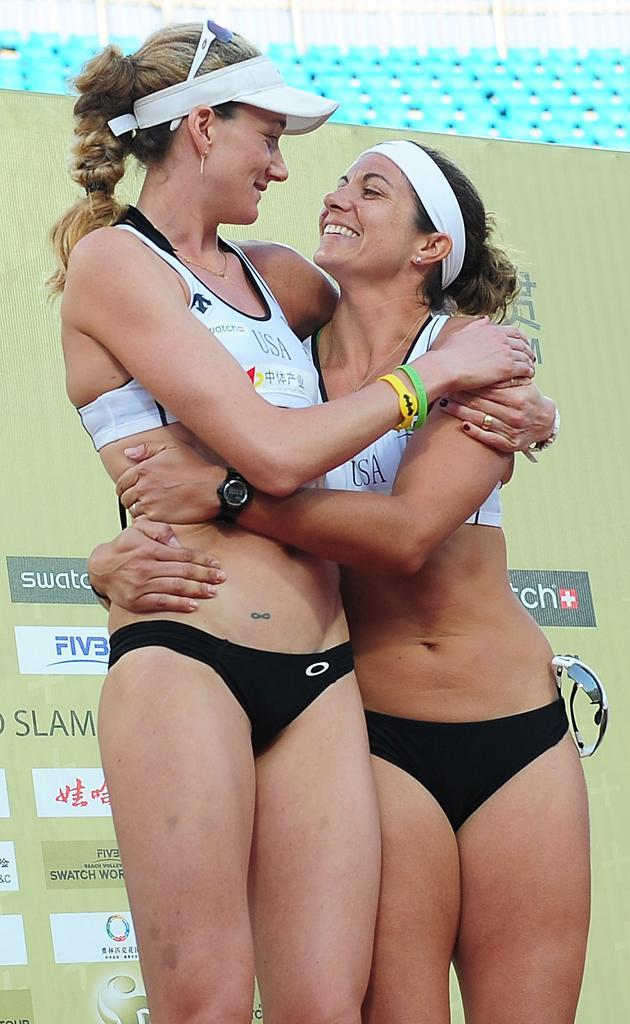 Closeup of USA Kerri Walsh (L) and Misty May-Treanor victorious with gold medal after winning Women's Gold Medal Match at the 2011 Swatch World Tour Beijing Grand Slam in Chaoyang Park on June 11, 2011 in Beijing, China.