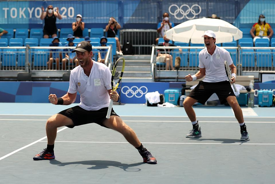 <p>TOKYO, JAPAN - JULY 28: Michael Venus of Team New Zealand and Marcus Daniell of Team New Zealand celebrate after match point during their Men's Doubles Quarterfinal match against Robert Farah of Team Colombia and Juan-Sebastian Cabalon of Team Colombia day five of the Tokyo 2020 Olympic Games at Ariake Tennis Park on July 28, 2021 in Tokyo, Japan. (Photo by David Ramos/Getty Images)</p>