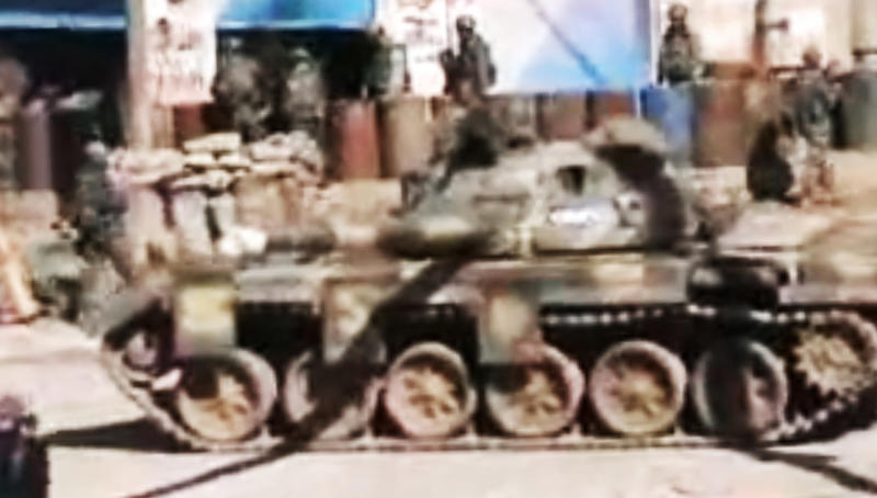 "This image made from amateur video and released by Shaam News Network Thursday, March 8, 2012, purports to show a Syrian military tank in Homs, Syria. Kofi Annan, who has been appointed joint U.N.-Arab League envoy to Syria, said his mission was to start a ""political process"" in Syria to resolve the one-year conflict there. The uprising began with largely peaceful protests but faced with a vicious regime crackdown, became increasingly militarized. The U.N. says more than 7,500 people have been killed in the yearlong violence. Activists put the death toll at more than 8,000. (AP Photo/Shaam News Network via APTN) THE ASSOCIATED PRESS CANNOT INDEPENDENTLY VERIFY THE CONTENT, DATE, LOCATION OR AUTHENTICITY OF THIS MATERIAL. TV OUT"