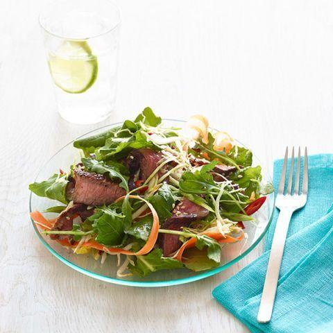 """<p>This easy salad is full of bright flavors that'll keep you coming back for seconds. Just turn on your broiler and get cooking. <br></p><p><em><a href=""""https://www.womansday.com/food-recipes/food-drinks/recipes/a12825/crunchy-thai-beef-salad-recipe-wdy0614/"""" rel=""""nofollow noopener"""" target=""""_blank"""" data-ylk=""""slk:Get the Crunchy Thai Beef Salad recipe."""" class=""""link rapid-noclick-resp"""">Get the Crunchy Thai Beef Salad recipe.</a></em></p>"""