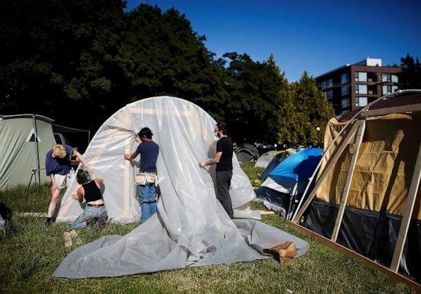 PHOTO: People set up a greenhouse space at a new community garden created by protesters at Cal Anderson Park as they demonstrate against racial inequality and occupy space at the CHOP in Seattle, June 16, 2020. (Lindsey Wasson/Reuters)
