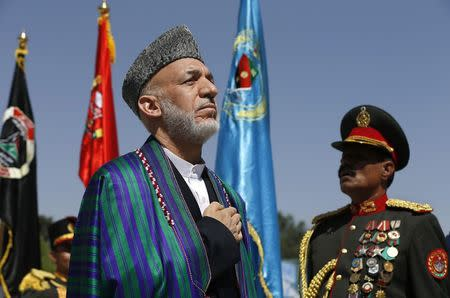 Afghan President Karzai attends an event to commemorate Afghanistan's 95th anniversary of independence in Kabul