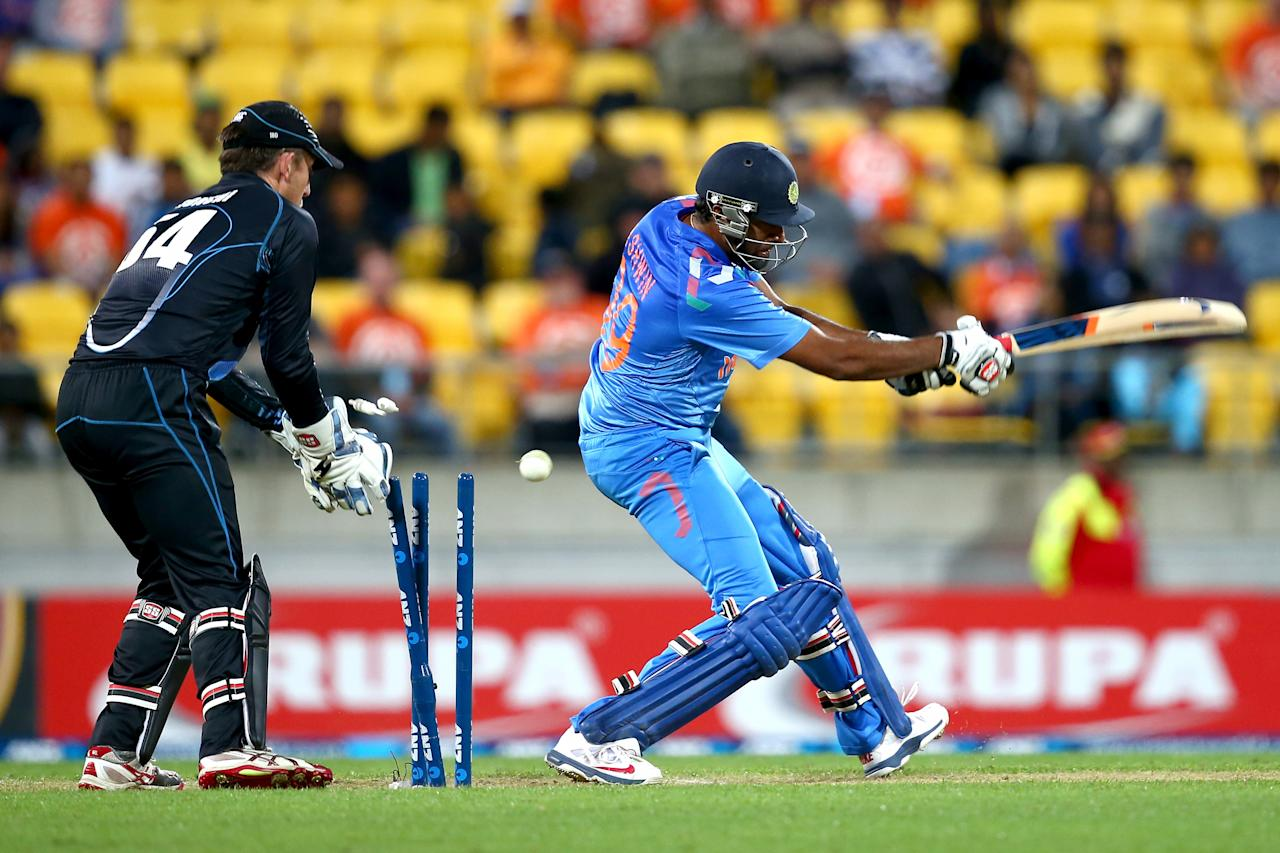 WELLINGTON, NEW ZEALAND - JANUARY 31: Ravi Ashwin of India is bowled by Kane Williamson of New Zealand during Game 5 of the men's one day international between New Zealand and India at Westpac Stadium on January 31, 2014 in Wellington, New Zealand.  (Photo by Phil Walter/Getty Images)