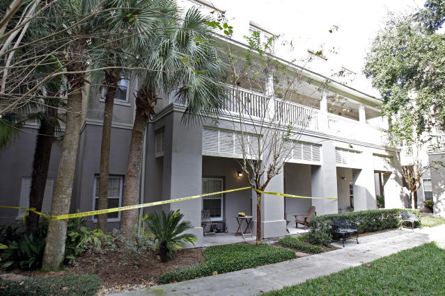 Crime scene tape surrounds a condominium, Wednesday, Dec. 1, 2010, where the first homicide has taken place in Celebration, Fla. The small town just south of Walt Disney World has never reported a homicide in its existence, until this week. (AP Photo/John Raoux)