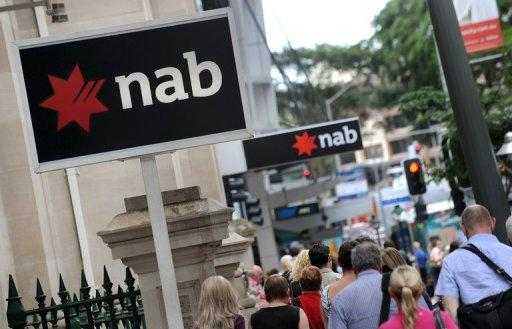National Australia Bank booked a profit of Aus$2.05 billion (US$2.06 billion) for the six months to March 31