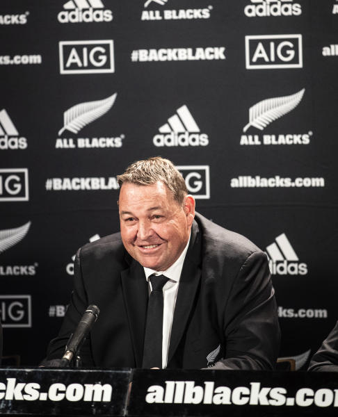 All Blacks head coach Steve Hansen smiles following the announcement of All Blacks squad for the Rugby World Cup at Eden Park, in Auckland, New Zealand, Wednesday, Aug. 28, 2019. Hansen has dropped 108-test veteran prop Owen Franks and gambled on the age and fitness of other players in naming a 31-man All Blacks which will attempt to win the Rugby World Cup for the third consecutive time. (Jason Oxenham/New Zealand Herald via AP)