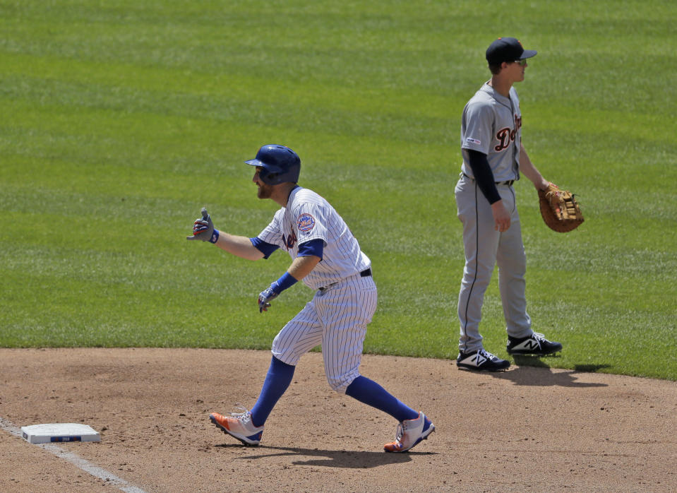 New York Mets' Todd Frazier, left, reacts after hitting an RBI-bunt single during the fourth inning of a baseball game against the Detroit Tigers at Citi Field, Sunday, May 26, 2019, in New York. (AP Photo/Seth Wenig)
